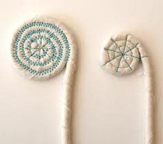 Coiled fabric baskets (center spiral)