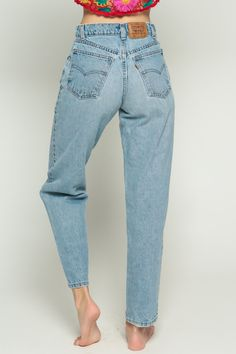 Vintage 80s jeans by Levis 550 with a super high waist and a Mom fit. Faded blue denim.  Every item we sell is authentic vintage and one-of-a-kind! You will receive the EXACT item shown in the photos. For reference, model is 59 and measures 32-23-36. DETAILS  Best fits: Small (Note: We only have ONE in stock. If more than one size is listed it is because this item will work on a range of sizes. Check measurements for exact fit.) Condition: Very good vintage (light general wear) – a few spots…