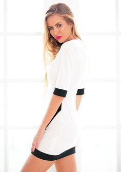 Side view of model in asymmetrical wrap style dress