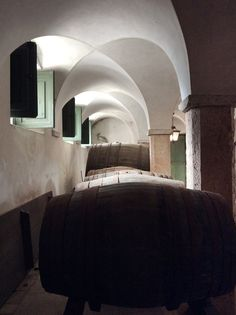 Another minimalist room, the wine cellar at the Correio-Mor nevertheless has nice vaulted ceilings and stone paving, beautiful lanterns and green shutters – not to mention those great big barrels. The ceiling heights also vary and indicate what was happening above: at the stables there would be accommodation (no doubt warmed up by the beasts' own heat), whereas the kitchen is a full double height space.
