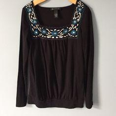Adorable black shirt with floral details. Soft black, long sleeve shirt with floral details. Worn once. INC International Concepts Tops Blouses