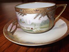 Handpainted Jeweled & Beaded Nippon cup and saucer- circa 1891-1921  -875. $35.00, via Etsy.