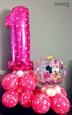 Here is a decoration idea for birthday party with a Minnie Mouse Bubble Balloon®*, Number Microfoil balloon and latex balloons. Find a balloon professional near you!Other items are not Disney licensed products. Minnie Mouse Birthday Theme, Theme Mickey, 1st Birthday Balloons, Birthday Balloon Decorations, Mickey Party, Minnie Mouse Party, 1st Birthday Parties, Bubble Balloons, Latex Balloons