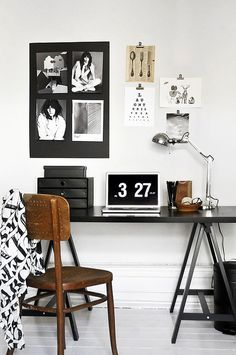 Wooden chair in contrast white work room.