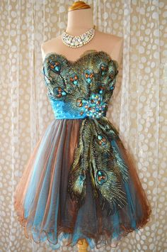 i think this is gorgeous <3 peacock cocktail dress.