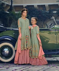 Kids Fern Green-Pink Patywear Sharara Dress Go to Measurement Form under About Us tab,to submit your detailed measurement for customized stitching Gowns For Girls, Dresses Kids Girl, Indian Dresses Traditional, Mom Daughter Matching Dresses, Pink And Green Dress, Kids Party Wear Dresses, Sharara Designs, Mother Daughter Fashion, Dress Indian Style