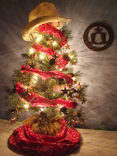 Cowboy Christmas Tree * Use gold stars, red bandana material and a cowboy hat for the topper.