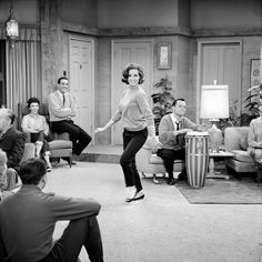 "Mary Tyler Moore, Ann Morgan Guilbert, Jerry Paris, and Bob Crane (on the drum) in a production still from ""The Dick Van Dyke Show"" (December 26, 1962)"
