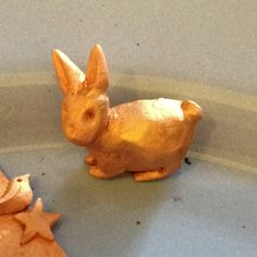 Little Copprclay bunny just out of the kiln.  Check my other pins on this board to see him as clay and after the first firing.