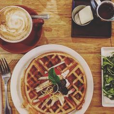 On rainy Saturday's we eat #waffles and drink #cappuccino in #berkeley #cafes #coffee #rainyday by zacharythomasshea