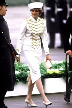 Prince Charles and Princess Diana greeted King Fahd of Saudi Arabia at Gatwick airport on his arrival in Britain.