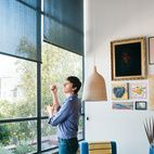Shelter from the Sun  Roller shades with a medium-opacity black cloth