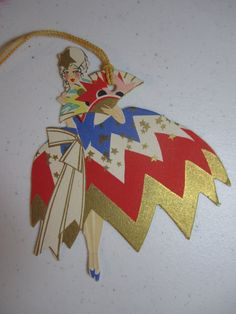 Unused art deco 1920's die cut gold gilded Buzza patriotic bridge tally colonial lady in powdered wig and red white and blue dress w/ stars