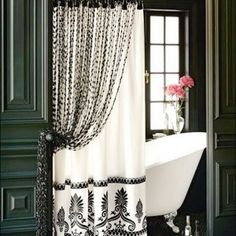 Batik Motif Black And White Shower Curtain Uk & Awesome Classic White Bathtub with Artistic Flower in the Nice Vase behind the Curtain & Aromatic Care Products on the Carpet