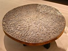 Beautiful table with an uneven surface... impractical but lovable