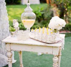 vintage table / yellow / drinks station / beverage dispenser / drinking jars