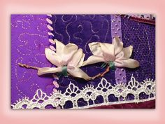 I ❤ ribbon embroidery . . . How to embroider a silk ribbon magnolia flower. www.craftyattic.com shows you how to embroider this silk ribbon embroidery flower. A straightforward film showing you how to form petals and stems & how to color your finished work.