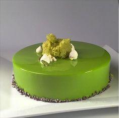 Mascarpone mousse, pistachio cremeux, mandarin gelee, almond sponge , pistachio crumble Entremet by Antonio Bachour