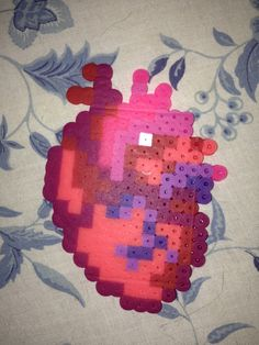A realistic and pixelated heart, designed by Pixelblock. I really like making hearts out of perler beads. Hama Beads Design, Diy Perler Beads, Perler Bead Art, Pearler Beads, Fuse Beads, Melt Beads Patterns, Fuse Bead Patterns, Perler Patterns, Beading Patterns