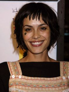 I like how effortlessly fun Shannyn Sossamon does her hair. 1) Apply a texture spray to damp hair. 2) Roughly blow-dry, working hair through your hands. 3) Take a mini flat iron and straighten sections for definition and shine.