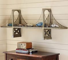 Bridge Shelf ~ $299.00 at potterybarnkids.com (It's from Pottery Barn Kids and says it would be a wow factor in a child's room, but I think it would look great in our game room area with my some of my husband's model car collection displayed on it!)