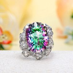 Rainbow Mystic Topaz is one of my favorite jewels. I LOVE THIS Ring