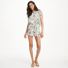 "We elevated the classic romper, adding a bright summery floral print and hundreds of fine knife pleats for movement. Polyester blend Relaxed fit 3"" inseam, based on a size 6 Round neck; ruffle detail at front and back; elasticized waist; partial open back with three fabric-covered buttons with loop closure Lined Dry clean Imported"