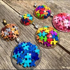 AUTISM AWARENESS PUZZLE PENDANTS by Chris Raley - made with hand-cut puzzle pieces in our Silicone Cabochons Mold, these awesome awareness pieces are so very special.  Thanks for sharing Chris!