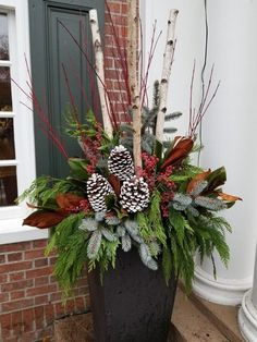 48 Favorite Christmas Porch Decoration Ideas If you really want to bring people into the Christmas spirit when they. Outdoor Christmas Planters, Christmas Urns, Christmas Greenery, Outdoor Christmas Decorations, Christmas Centerpieces, Christmas Holidays, Christmas Wreaths, Christmas Crafts, Holiday Decor