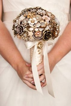 This custom jewelry brooch bouquet is a good example of a special niche or one-of-a-kind homemade design. Miranda Lambert also carried a bouquet like this in her wedding.  This idea seems to be a continuing trend.