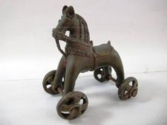 Antique Lead Horse On Wheels Toy