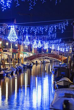 Christmas decorations reflected in a canal, Murano, Venice, UNESCO World Heritage Site, Veneto, Italy, Europe