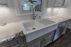 A closer look at the farm sink and the beautiful Alpinus granite.
