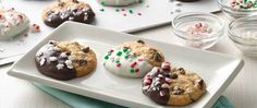 All dressed up and ready to party! Chocolate chip cookies are dipped in chocolate and topped with holiday sprinkles for an easy treat at any holiday occasion.