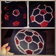 "Graduation cap soccer design!   Materials: Variety sizes bag of gems. Pack of sequins. Tack-it glue. Soccer ball clip art 8""x8"". Metallic permanent marker. Tweezers. Scissors."
