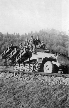 A Stuka zu Fuss SdKzf 251 Halftrack carrying it's Nebelwerfer rockets loaded in the launch crates on it's sides.
