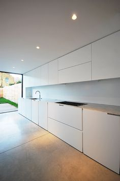 Minimalist Interior, Terraced house refurbishment, Kitchen Space, Carrara Marble Worktop, Concrete Flooring, Skyframe Glass, Queens Park , London , LBMVarchitects