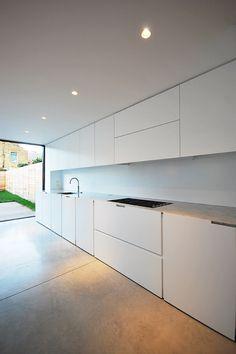 Minimalist Interior, Terraced house refurbishment, Kitchen Space, Carrara Marble Worktop, Concrete Flooring, Skyframe Glass, Queens Park , London , LBMVarchitects