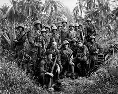 U.S. Marine Raiders gathered in front of a Japanese dugout on Cape Torokina on Bougainville