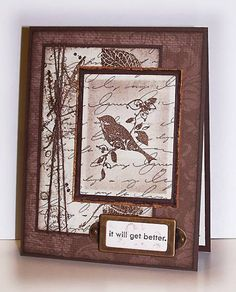 all brown layers of paper, stamping + embellishments...bird, writing leaves...complex but unified by the color..
