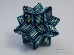 So I've finally finished the pair of beaded shapes I was working on over the last few months! Here they are – a rhombic hexecontahedron and what is probably best described as a hyperbol…