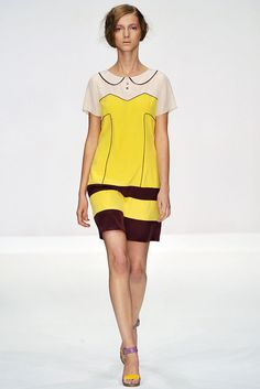 This is a dress by Eley Kishimoto that was featured in the Spring 2009 Ready-to-Wear Fashion Show. This look references the surrealist trend of the 1920s. This look is deceptive to the eye because it is all one knitted piece.