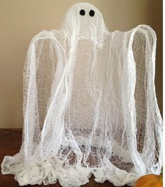 Cheesecloth Ghost - I think the kids and I will make one (or 3 tiny ones) this weekend!