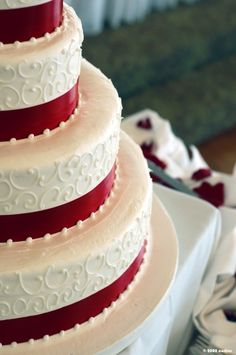 red velvet wedding cake ... bigger picture and different site. STILL LOVE THIS CAKE.