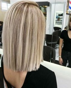 Blunt short cut with beautiful, dimensional highlights.