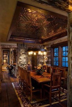 Gorgeous western design.  Love this ceiling, lighting, rustic furniture, and saddle barstools..