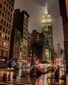 Fog over the Empire State Building at rainy night