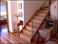 Full timber stair with wrought iron balustrade (beautiful colour timber)