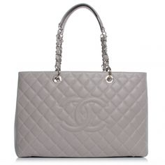 CHANEL Caviar XL Grand Shopping Tote GST in Grey NEW.   This stunning tote is beautifully crafted of luxurious diamond quilted caviar leather with shoulder straps with silver chain links threaded with leather and leather shoulder pads.