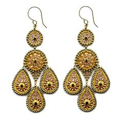 These show-stopping chandelier earrings are hand woven with Swarovski crystals, Japanese Miyuki glass beads, and 18-karat gold plated rondelles on 14-karat gold fill. The rose and peachy gold tones are the perfect compliment to the Spring and Summer color palette while the intricate design radiates a cool bohemian flair. The earrings are finished with French ear wires for a secure and comfortable fit. Swarovski Crystal & Miyuki Chandelier Earrings – Favery